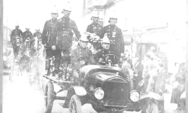 Firemen escorting Phillips' coffin at his funeral