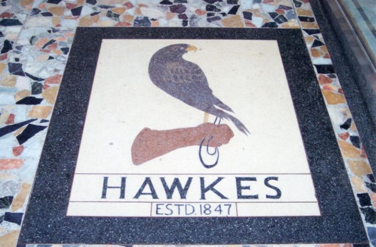 Hawkes logo on shop tiled floor